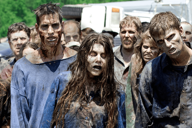 A group of zombies head toward the camera in a scene from 'The Walking Dead'