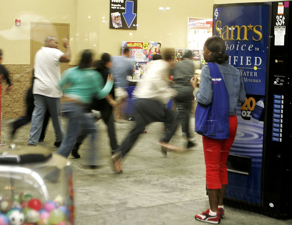 Crowds rush into a Walmart store as the doors open at 5am to scoop up good deals on heavily discounted merchandise