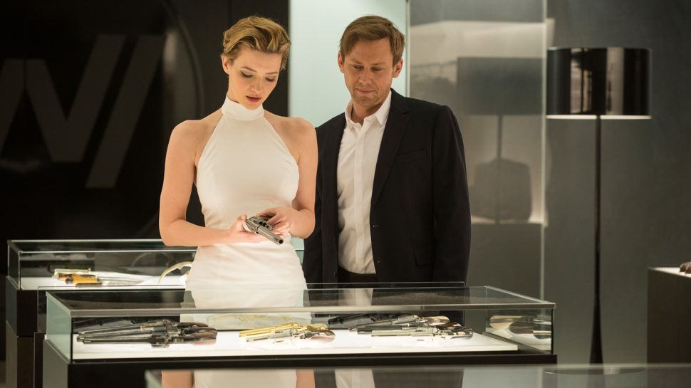 Talulah Riley and Jimmi Simpson looking at a display case of guns on Westworld