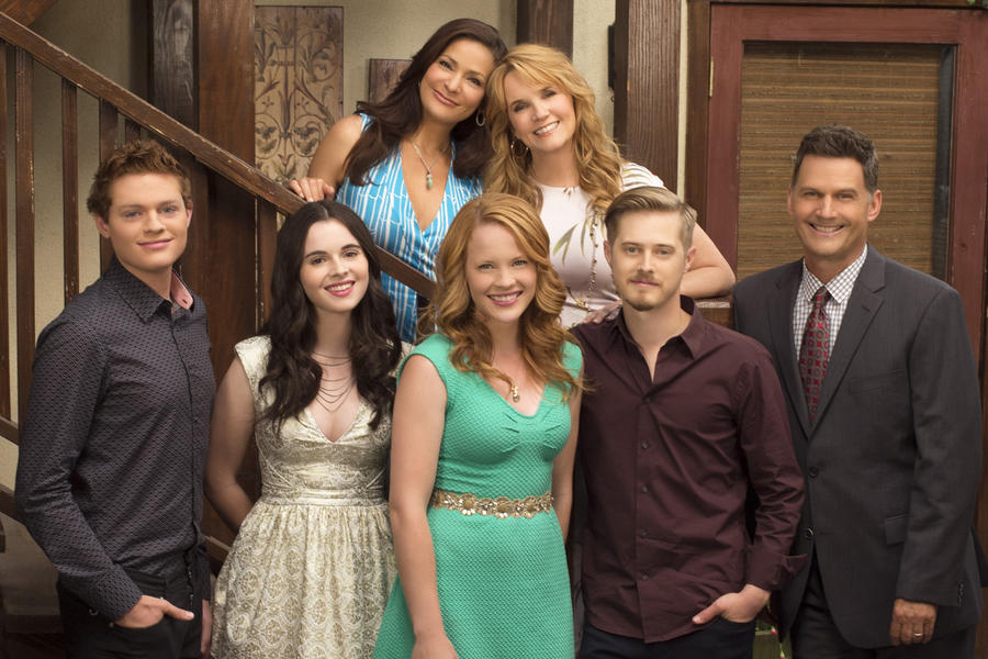The cast of Switched at Birth pose on the stairs