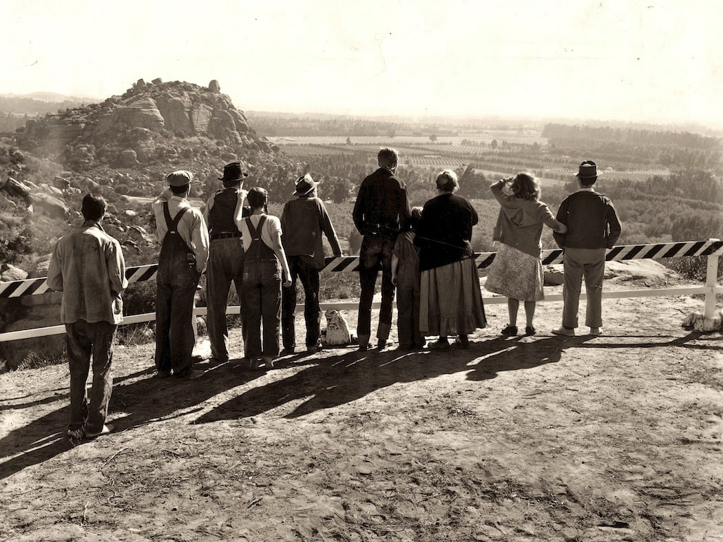 The characters from the film Grapes of Wrath look out over California, the land of money, jobs, and opportunity