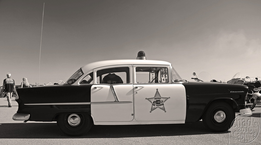 An old 1955 Chevrolet Bel Air being used as an American cop car