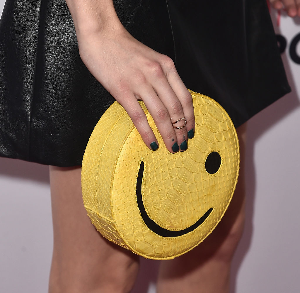 Actress Emma Roberts, purse detail, attends the 3rd Annual Airbnb Open Spotlight