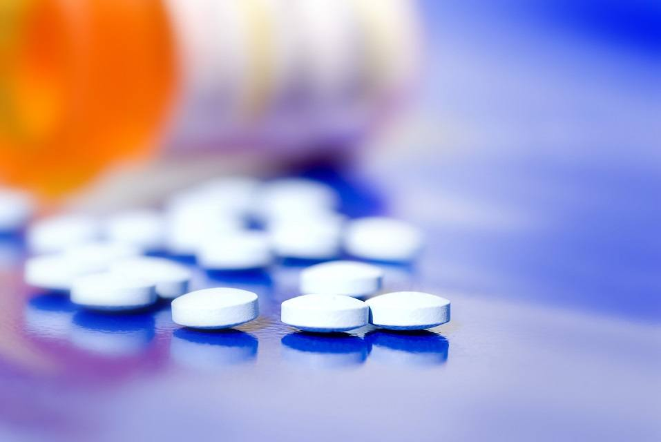 pain killer pills on blue background