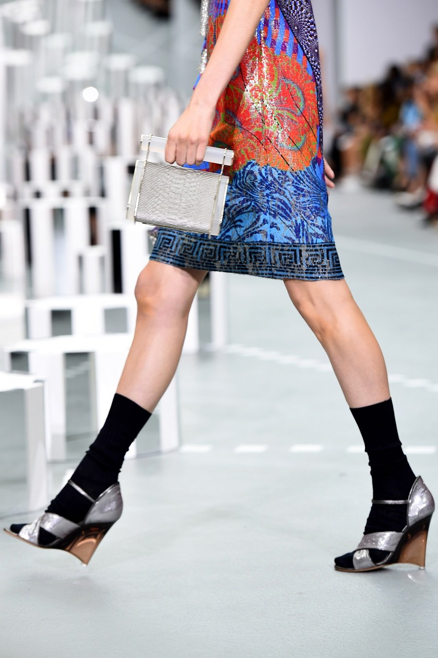 A model carries a clutch bag at the Mary Katrantzou show during London Fashion Week