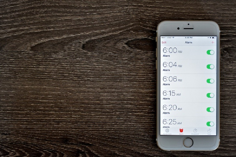 An Apple iPhone 6s displaying the alarm clock application