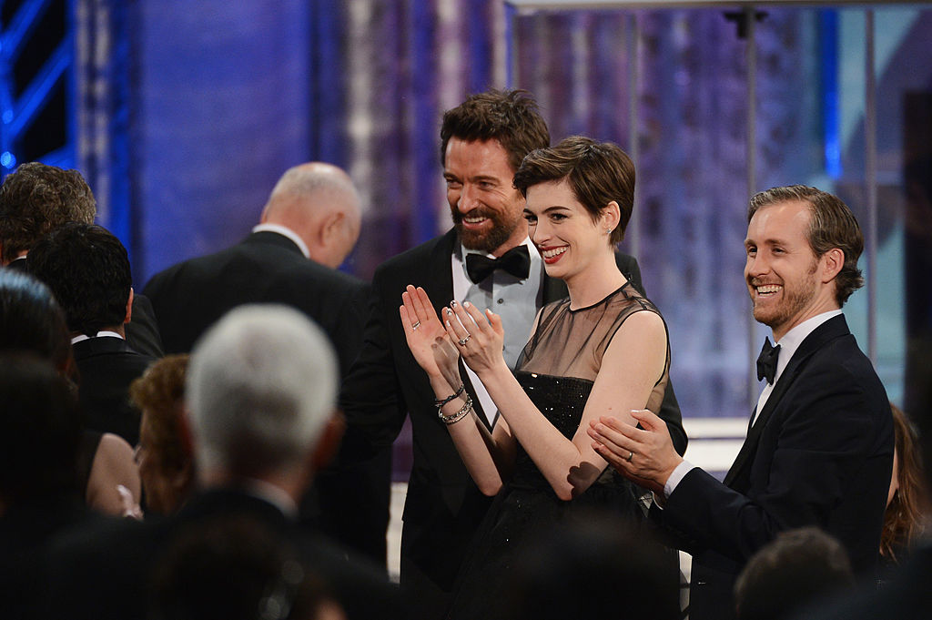 Actors Hugh Jackman, Anne Hathaway, and Adam Shulman