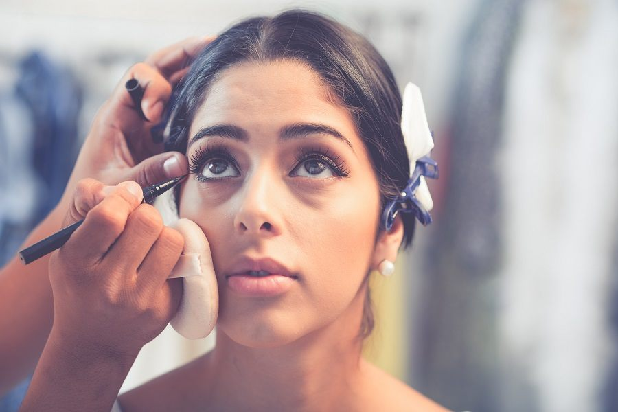 Girl looking up to let make-up artist