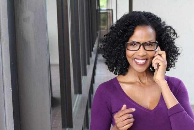 A business woman talks on her smartphone