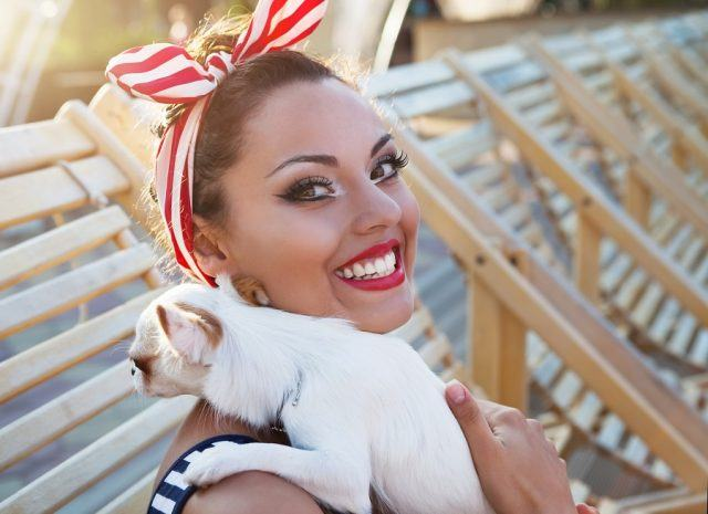 Beautiful pin up girl with puppy