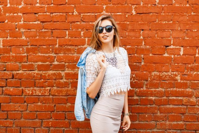 woman in stylish vintage white blouse with denim jacket