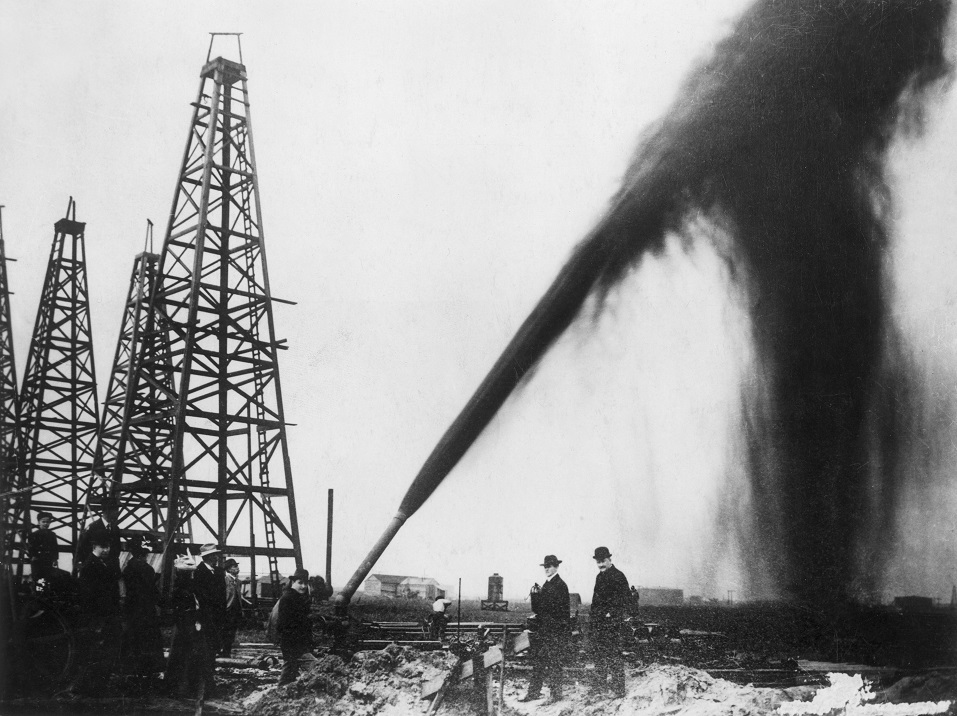 Oil gushing out of a pipe on an oilfield