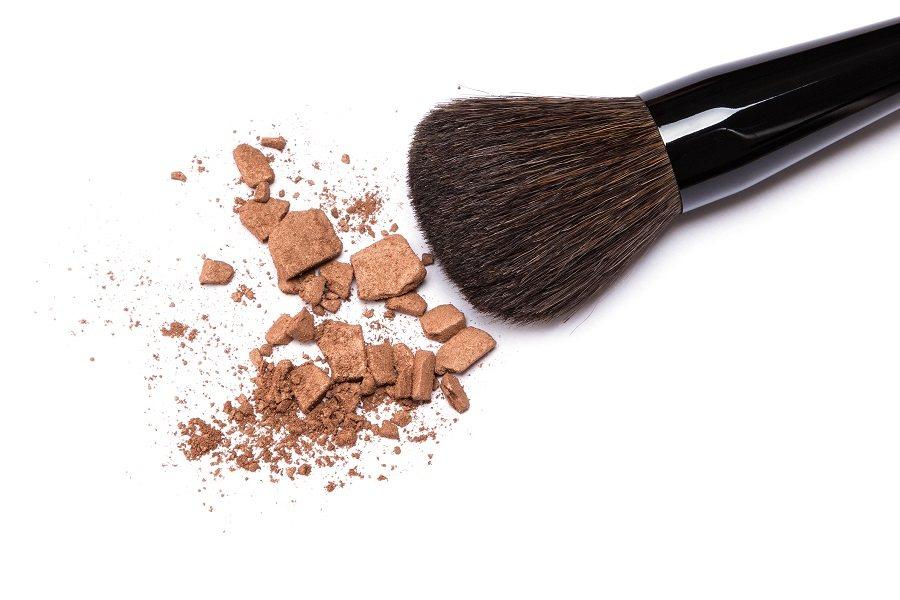 crushed bronzing powder with makeup brush
