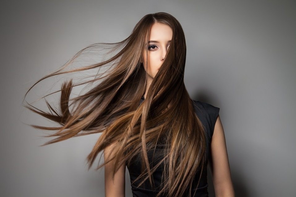 calm emotionless model with long windy hair