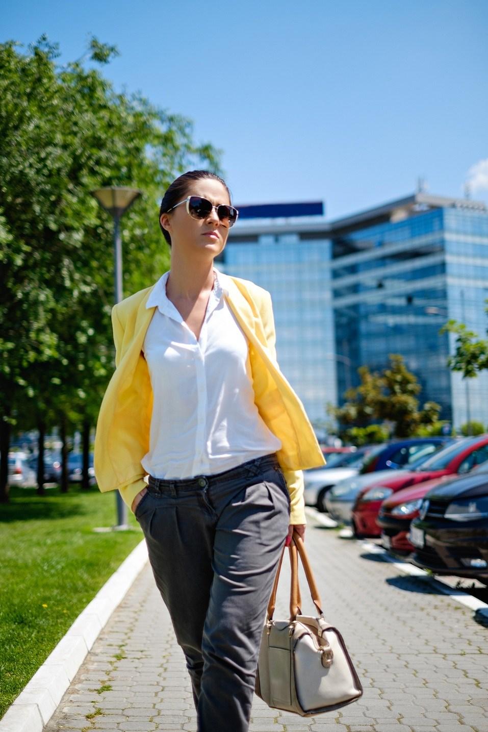Woman walking in a hurry on the sidewalk