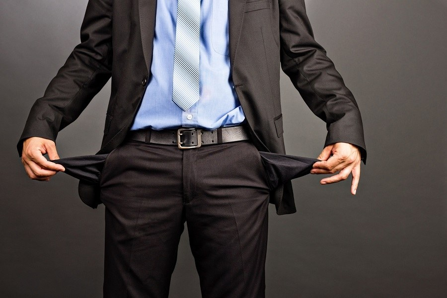 a broke man pulls out his pockets after a job rejection