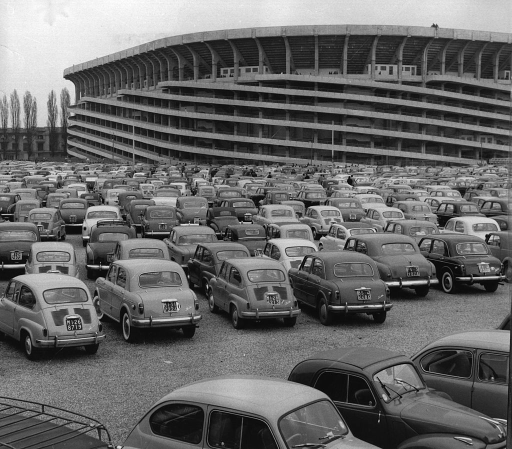 A collection of cars parked in a car park