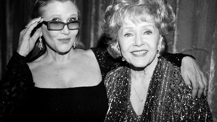 Carrie Fisher and mother Debbie Reynolds posing together in black and white