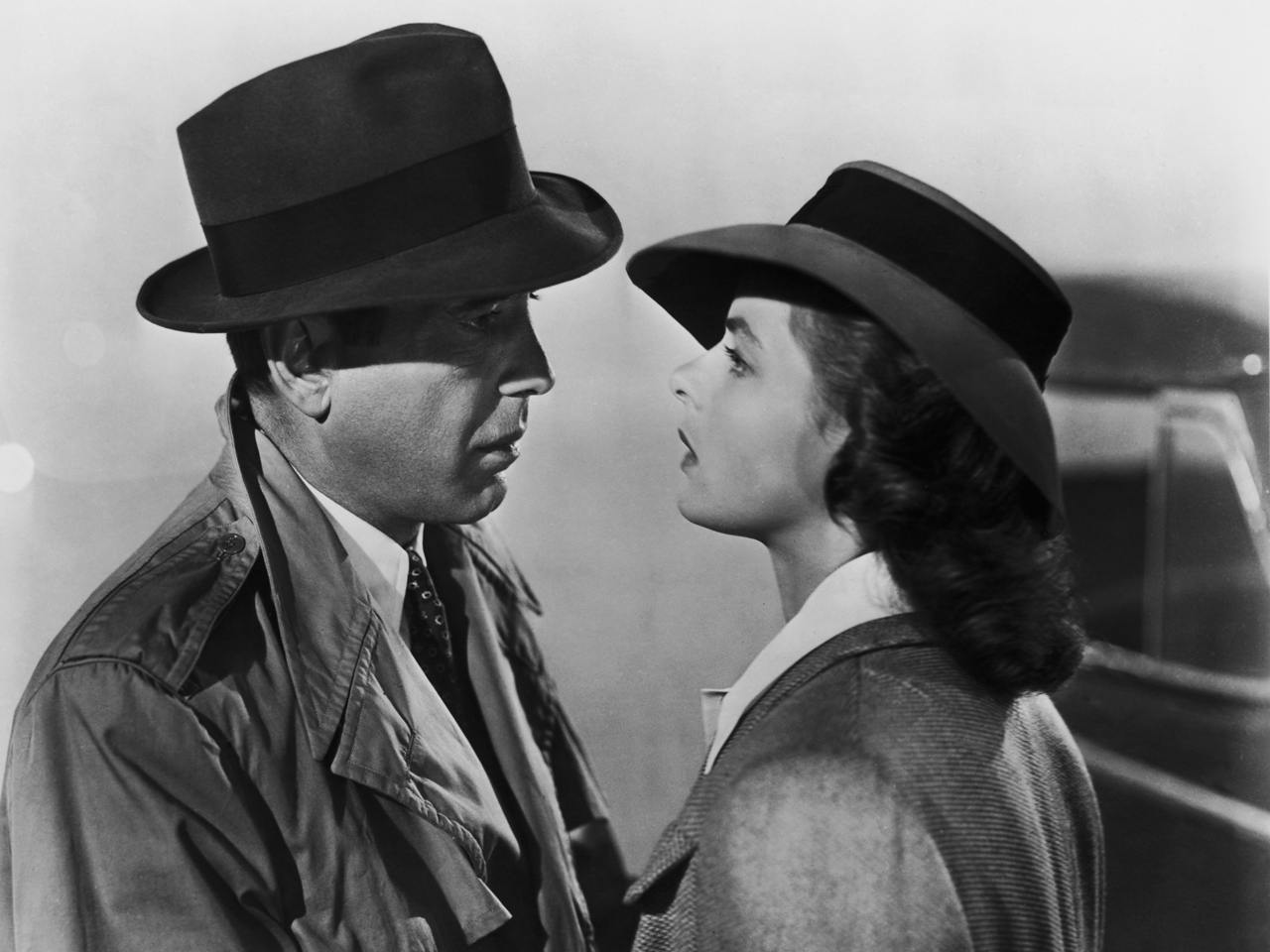Humphrey Bogart and Ingrid Bergman talking in Casablanca.