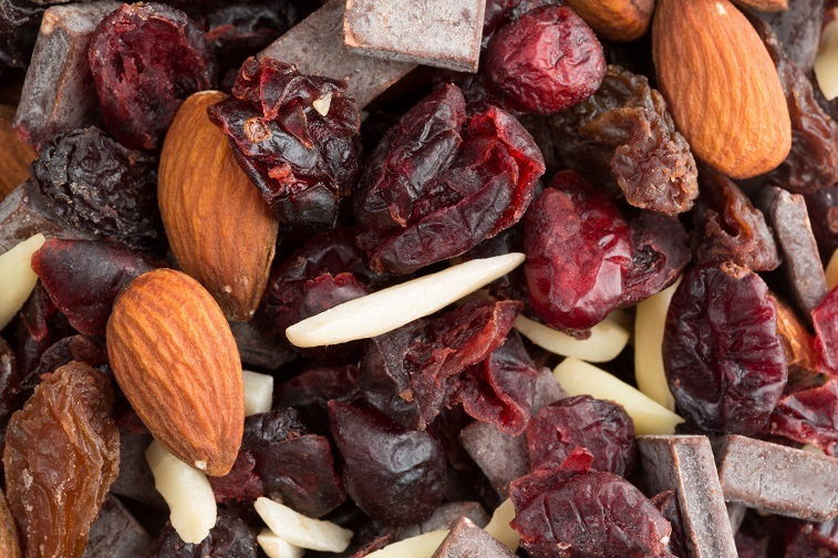 trail mix consisting of dried cranberries, sliced almonds, raisins and chunks of chocolate
