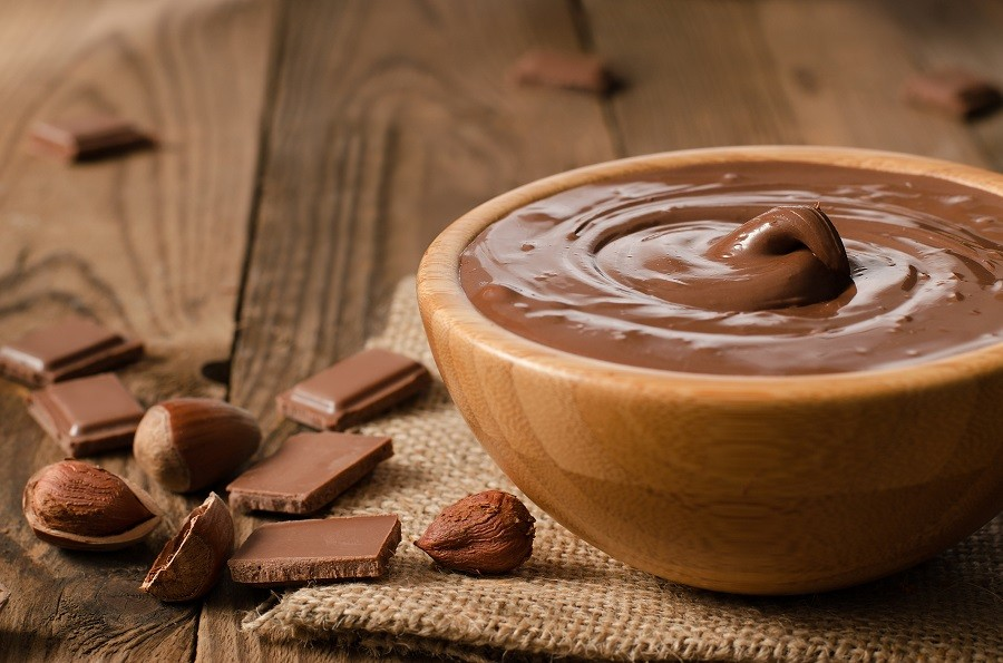 chocolate sauce in a bowl on jute