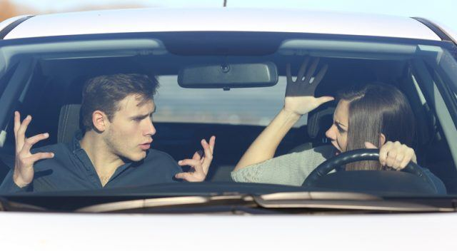 Couple arguing while driving.