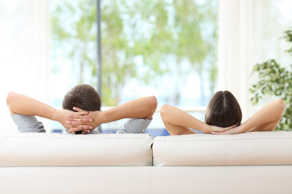 couple relaxing on a sofa at home