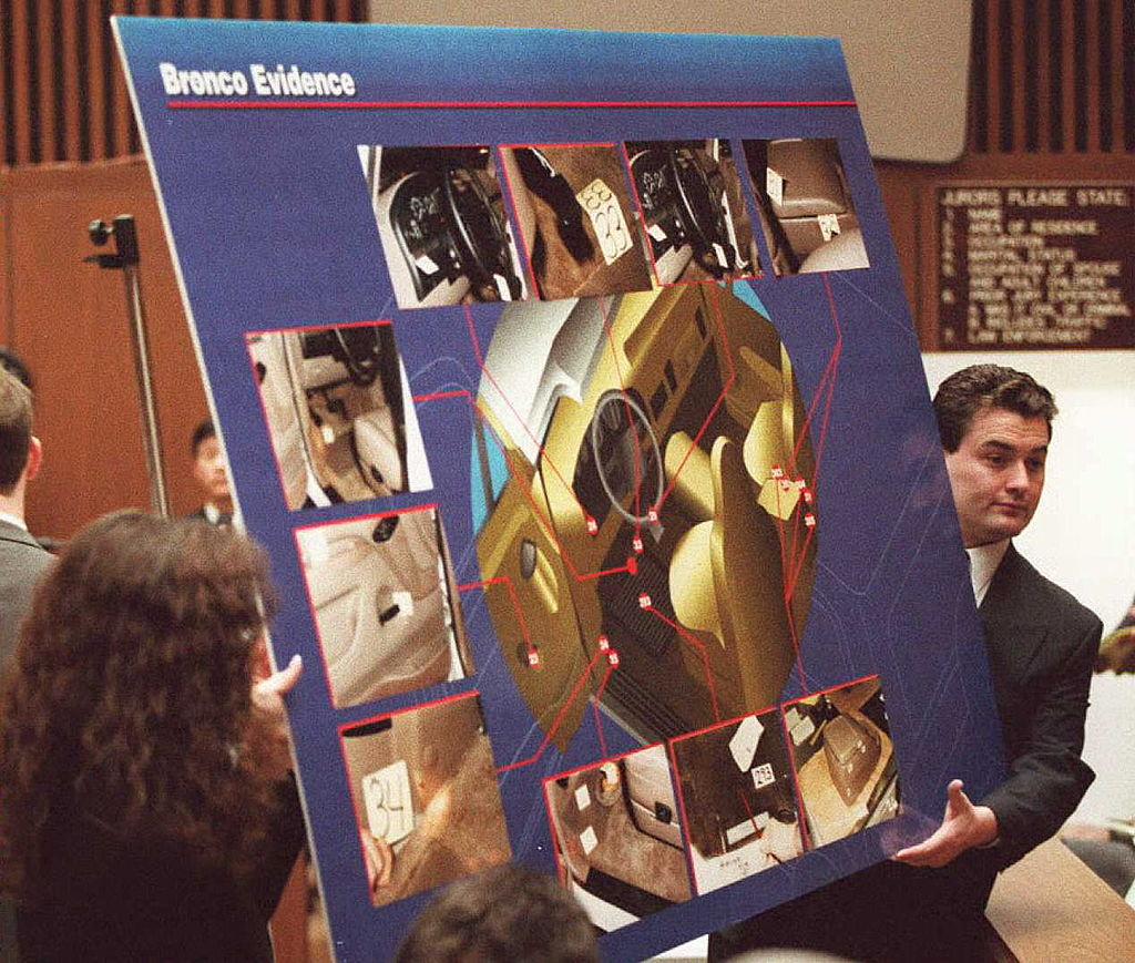 Court aides display a chart to the jury 04 April showing pictures and a diagram of where blood was found in O.J. Simpson's Ford Bronco during the O.J. Simpson murder trial in Los Angeles