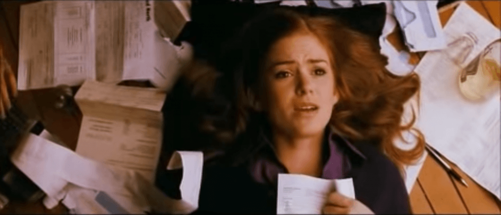Isla Fisher in Confessions of a Shopaholic, holding a credit card bill