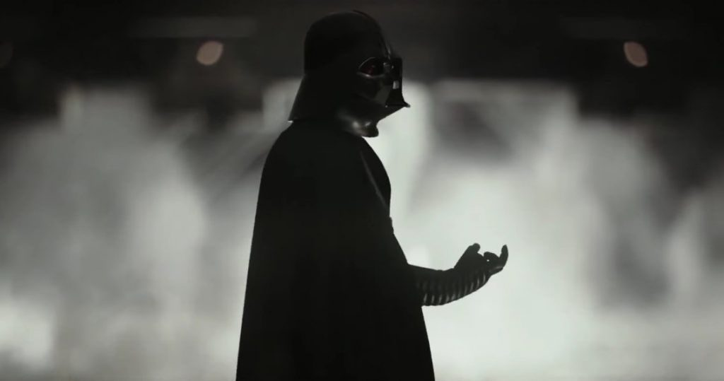 Darth Vader looking back with his hand curled in Rogue One