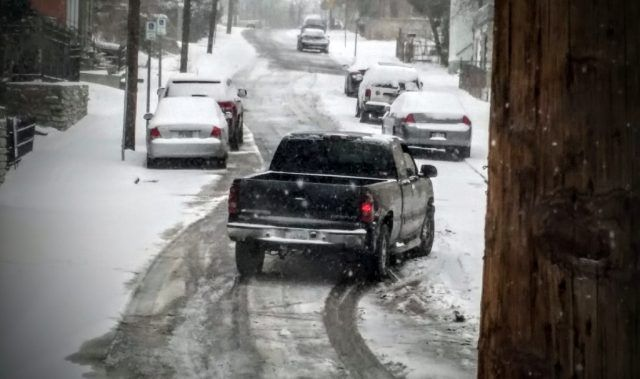 A novice driver jerks the wheel sharply and stalls out while trying to ascend a snowy hill in winter. | Micah Wright/Cheat Sheet