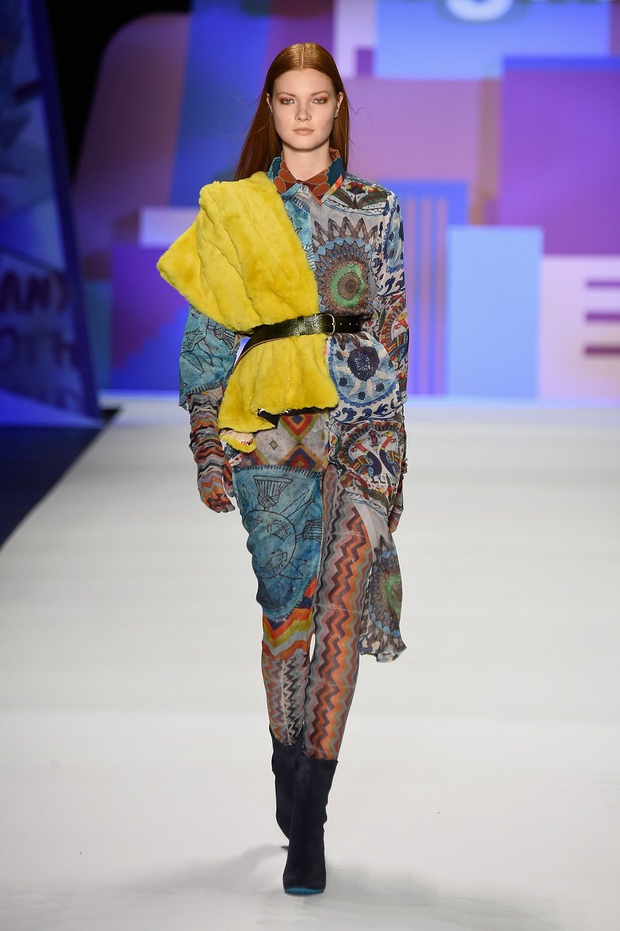 A model walks the runway wearing Desigual Fall 2016