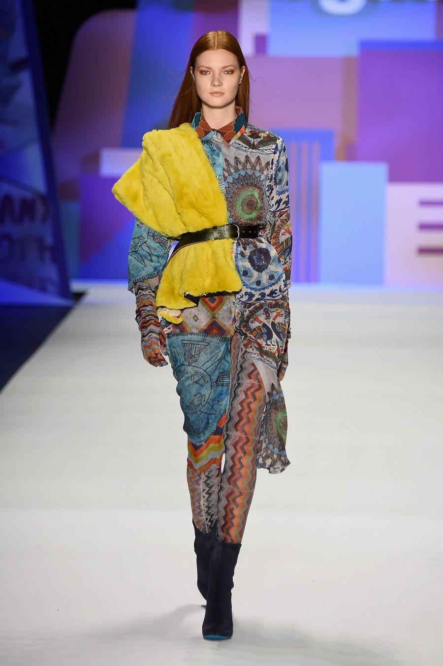 A model walks the runway wearing Desigual Fall 2016