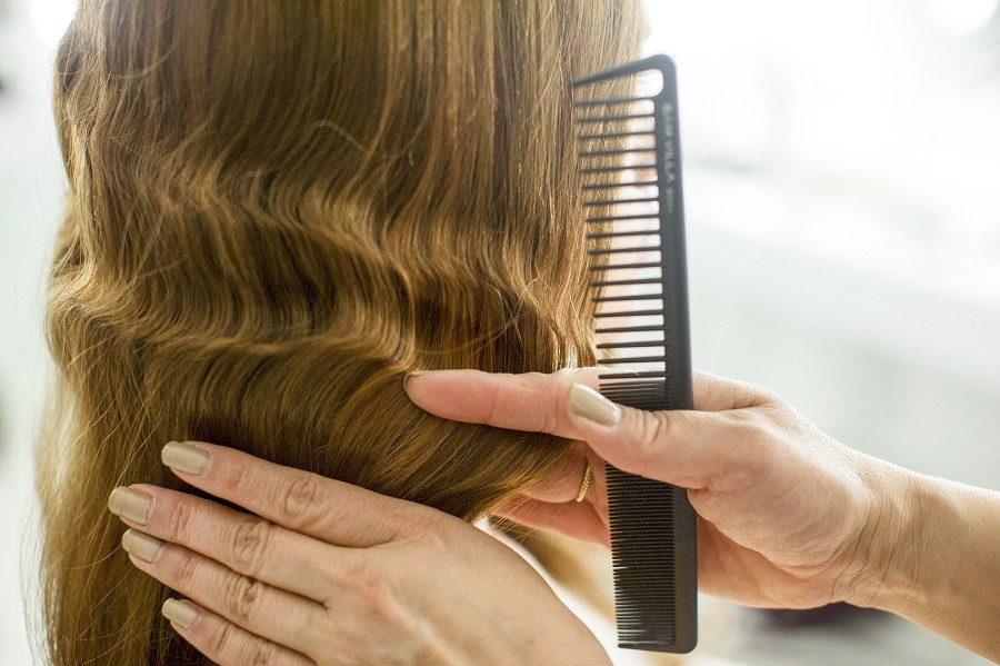woman getting finger waves in her hair