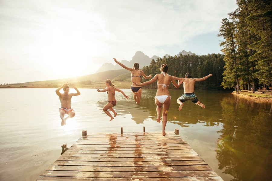 Young people having fun at the lake on a summer day