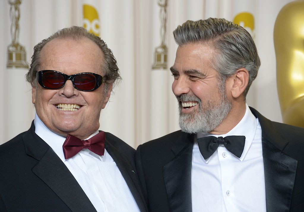 Jack Nicholson (L) and George Clooney pose in the press room