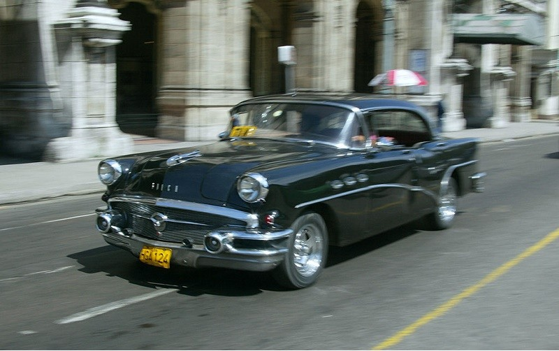 Picture taken 06 May 2004 downtown Havana of a 1950's Buick, an American classic car. Cars are probably the most valuable luxury items in Cuba, not to mention a necessity for some, and the skills and resources necessary to maintain a car not only provides the best job, but having such skills considered a well-kept secret, passed down from father to son through the generations. The Cubans consider the family car, and its clean-running engine, like a Wedding Car Frenchman or Californian thinks of his vineyard. Up until The Revolution in 1960, Cuba was the largest importer of American Cars.