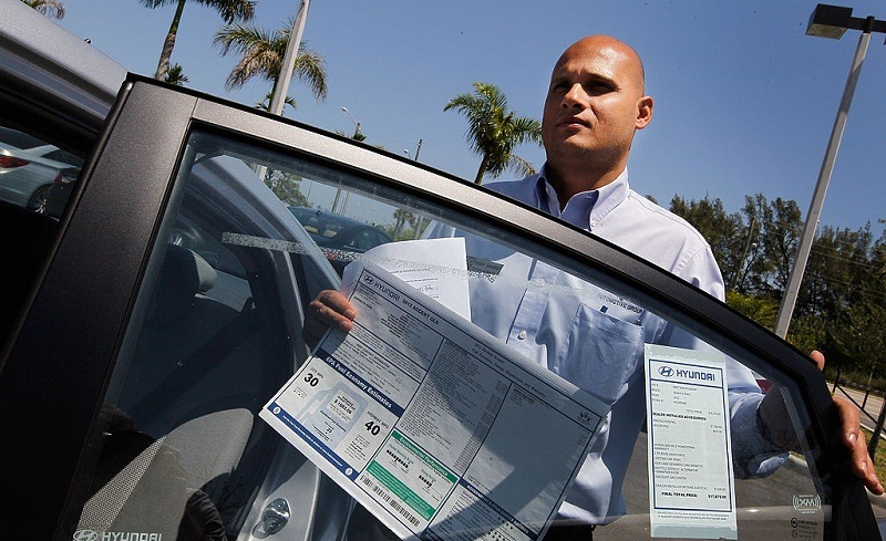 PLANTATION, FL - APRIL 03: Car salesman Hazem Sakallah prepares a car for a customer at Rick Case Plantation Hyundai on April 3, 2012 in Plantation, Florida. Reports indicate that automakers expect to have sold more than 1.4 million vehicles in March, about 15 percent more than a year ago and the most since 2007.
