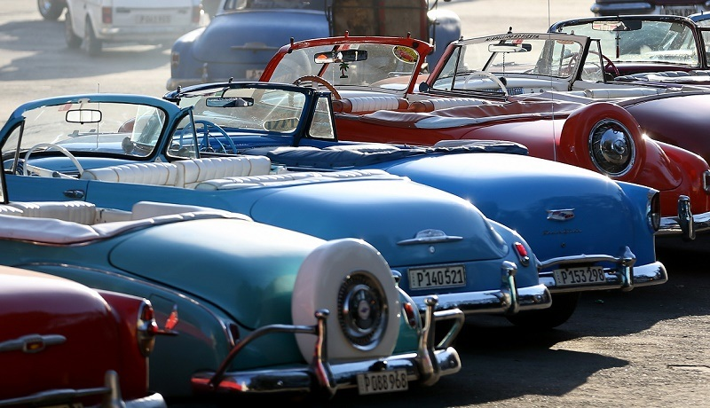 HAVANA, CUBA - FEBRUARY 28: Vintage American automobiles are seen on the street as their owners wait for tourists wanting a ride a day after the second round of diplomatic talks between the United States and Cuban officials took place in Washington, DC on February 28, 2015 in Havana, Cuba. The dialogue is an effort to restore full diplomatic relations and move toward opening trade.