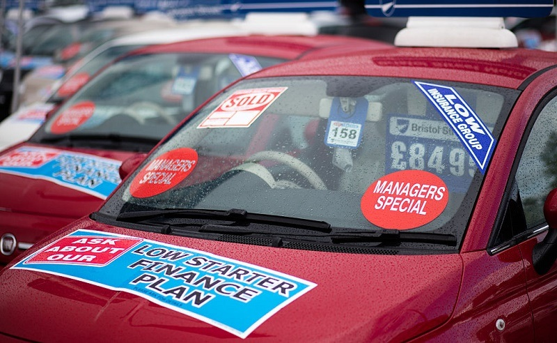 BRISTOL, ENGLAND - OCTOBER 06: A brand new Fiat car is offered for sale on the forecourt of a main motor car dealer in Brislington on October 6, 2015 in Bristol, England. Latest data from the Society of Motor Manufacturers and Traders (SMMT) show a record 462,517 new cars were registered in the UK last month, a 8.6% year on year increase, and that total sales in the year to date have hit 2,096,886, 7.1 percent higher than the same point last year and the first time the two million mark has been passed in September since 2004. The figures also showed a slight drop in the levels of drivers choosing diesel-engined cars, claimed in part to be due to the scandal that has surrounded Volkswagen and the disclosure that they cheated emissions tests on their diesel cars.