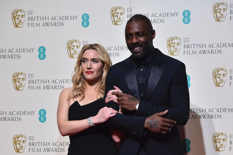 Kate Winslet and Idris Elba | Ben StansallL/AFP/Getty Images)