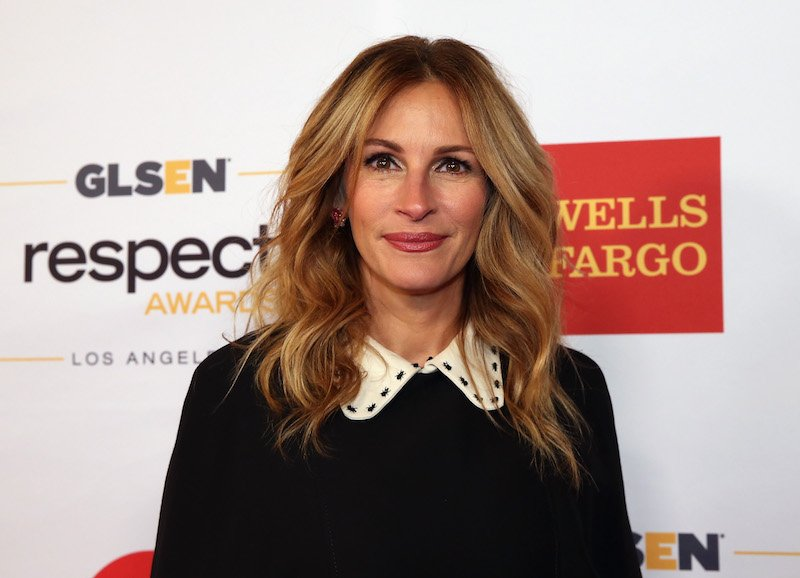 Julia Roberts smiling, in front of a Wells Fargo background on the red carpet