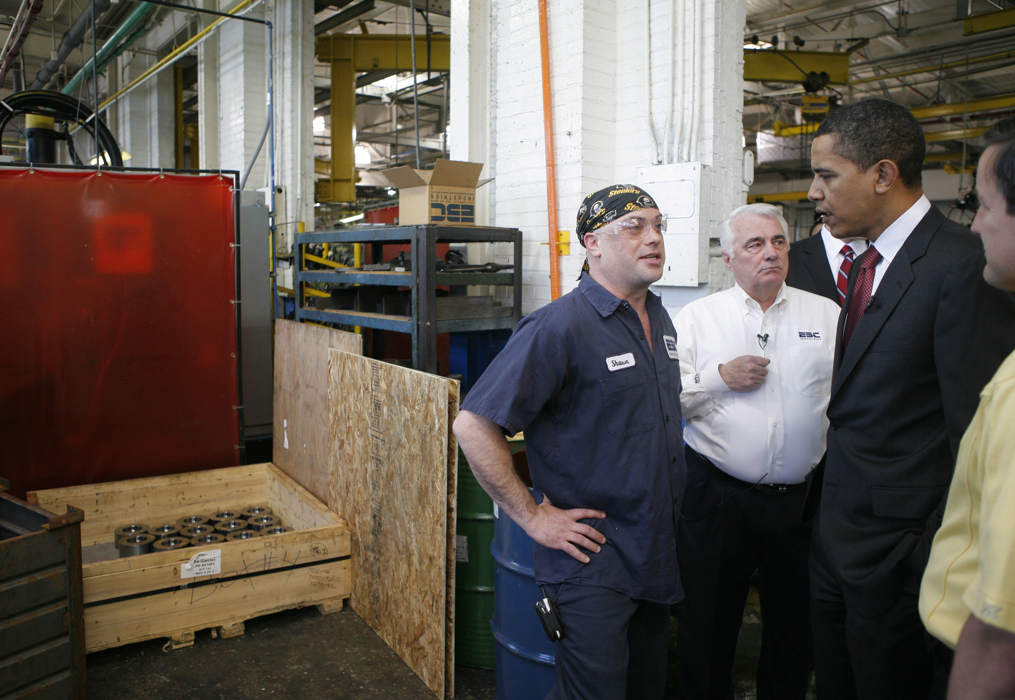 In 2008, then-candidateBarack Obama talks with workers while touring the bolt manufacturer Erie Bolt Company in Erie, Pennsylvania