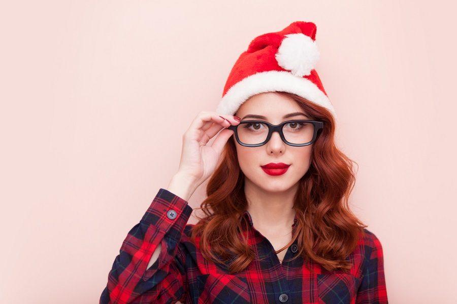 A girl wearing a Santa Claus hat