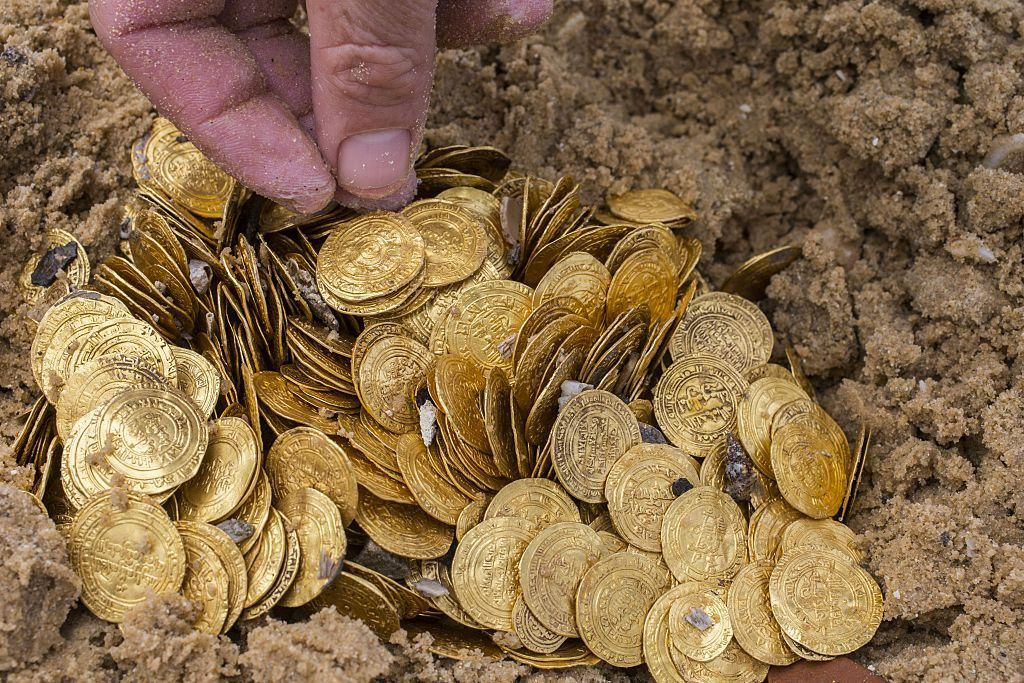 Gold coins in the sand