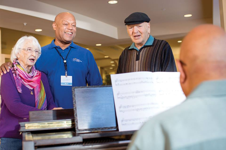 A Good Samaritan Society employee helps an elderly couple
