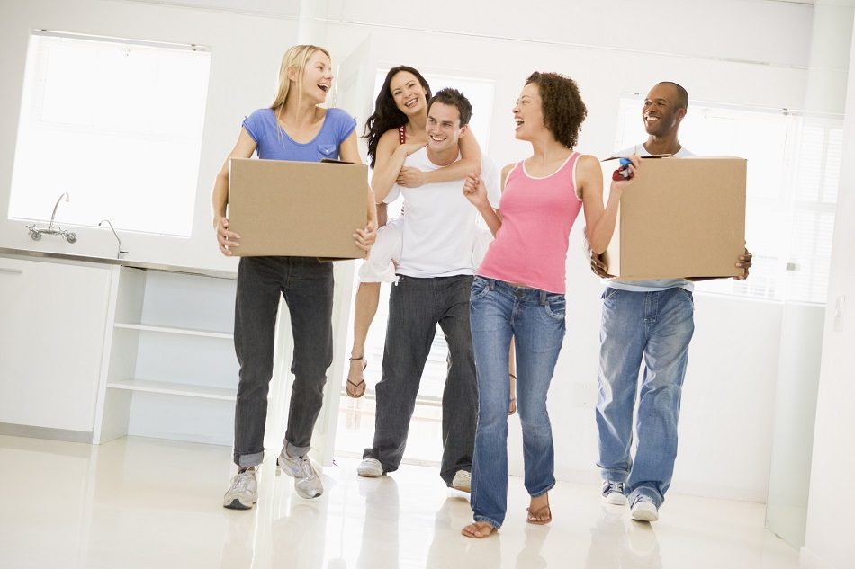 Group of friends moving into new home