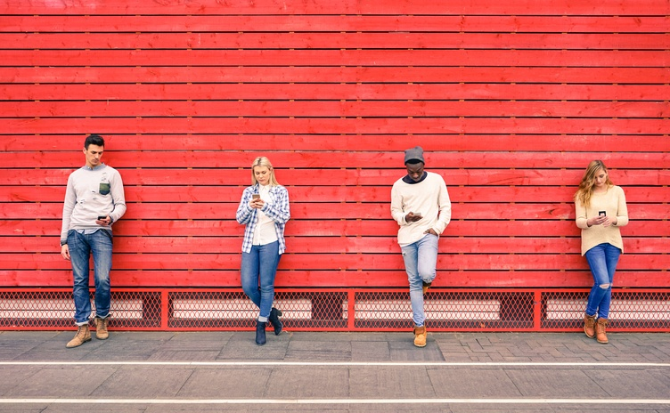 Group of multiracial fashion friends using smartphone