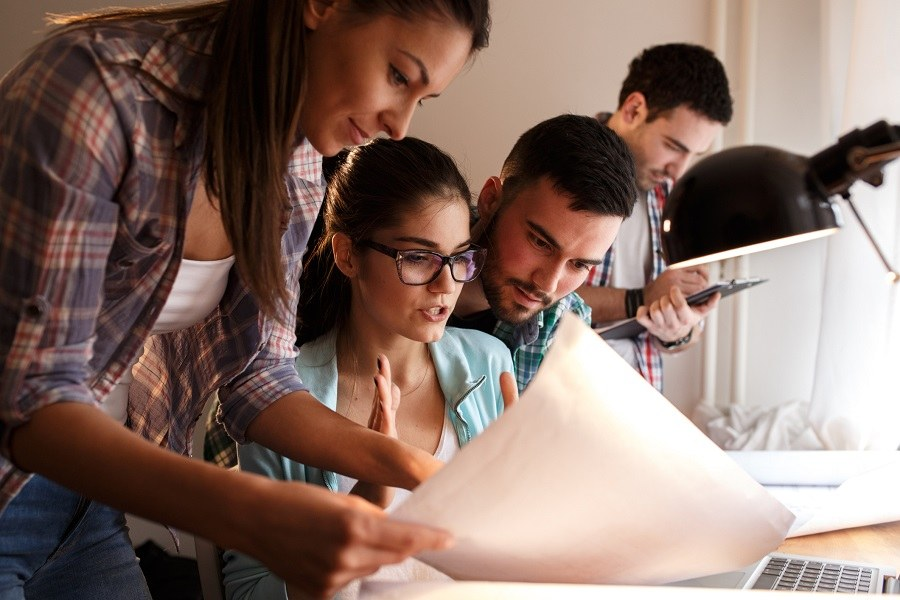 young business people and designers working together on a project