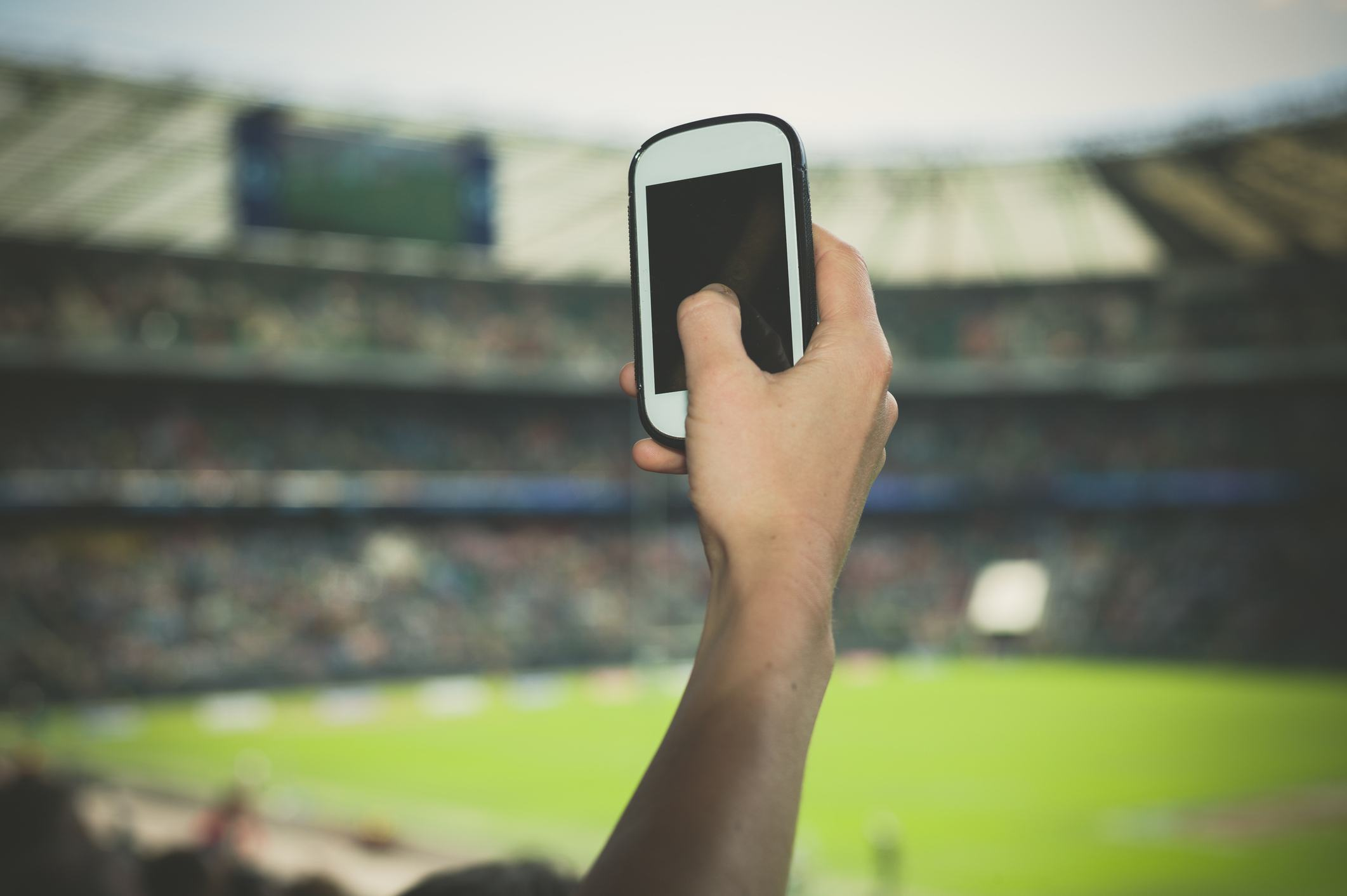A female hand is holding a smartphone